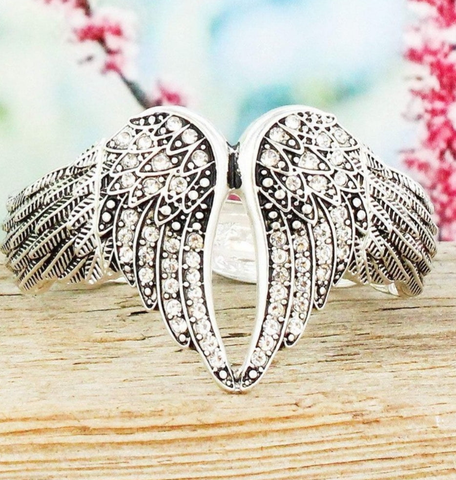 CRYSTAL ACCENTED ANTIQUE SILVERTONE WING STRETCH BRACELET