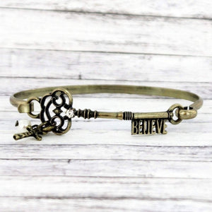 BURNISHED BRASSTONE 'BELIEVE' KEY WITH CHARMS BRACELET-AVAILABLE FOR PRESALE UNTIL APRIL 11