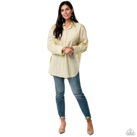 A comfy oversized top, boyfriend jeans and heels represent the Paparazzi Casual Business 2021 Spring Fashion Trend.
