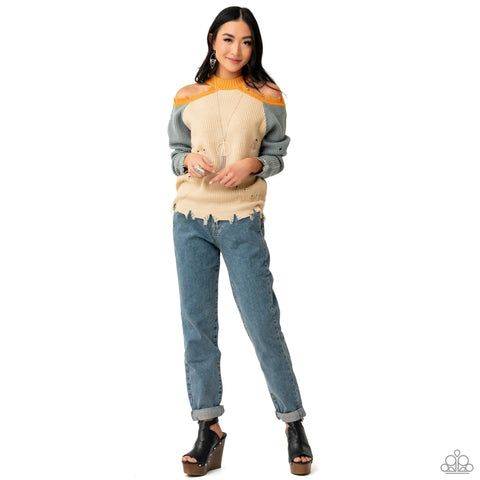 An intentionally tattered sweater, casual jeans and bold black leather shoes represent the Paparazzi #NoFilter 2021 Spring Fashion Trend.
