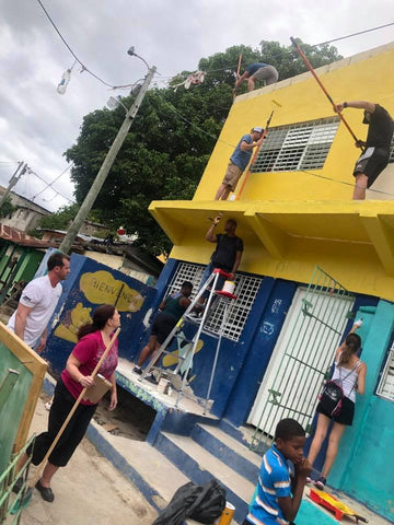Painting a school in La Romana, Dominican Republic during the 2019 Paparazzi Passport trip service project.