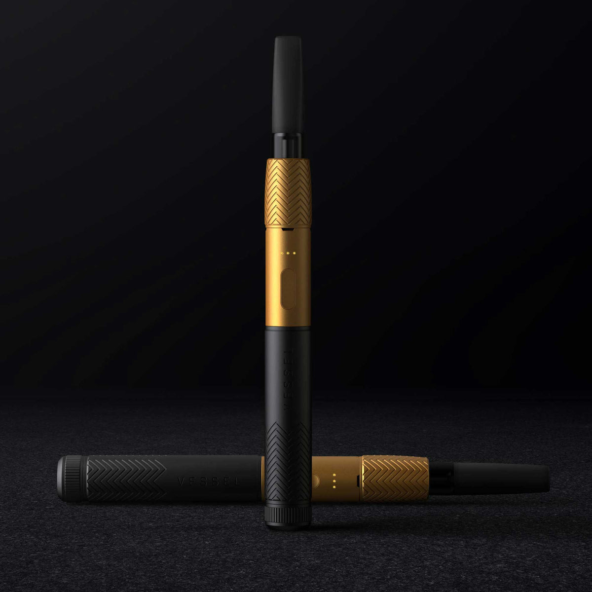 Two Black and Gold Vape Pen Batteries