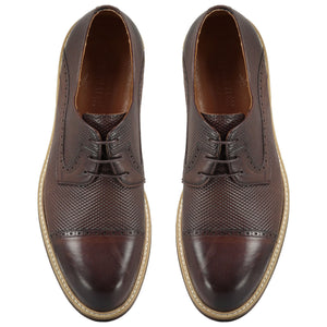 Top perspective for brown shiny shoes with lace