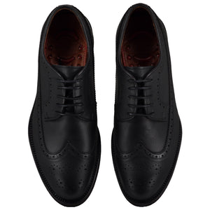 Top view of casual wingtip lace-up with black dress shoes for men