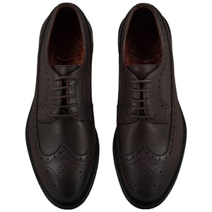 Top view of casual wingtip lace-up with brown dress shoes for men