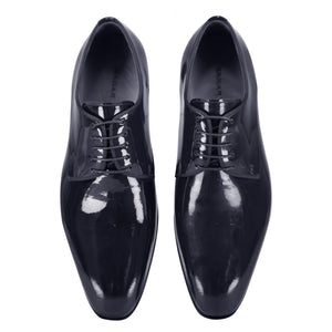 Top view of dark blue classic lace-up shiny dress shoes for men