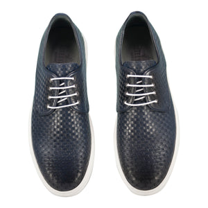 Top view of casual lace-up dark blue dress shoes for men