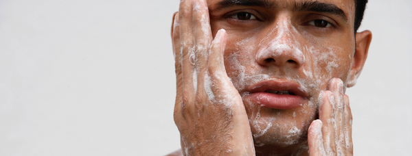 The best plastic-free alternatives - a man rubs soap on his face