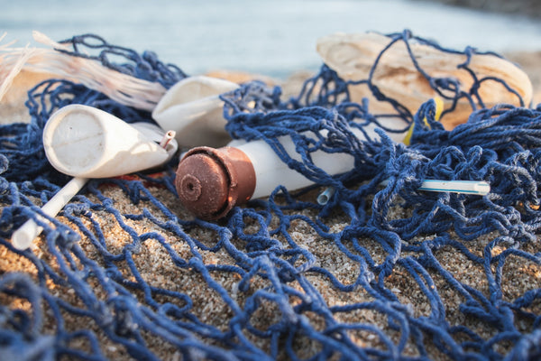 Plastic Free July: A fishing net entangled with plastic bottles