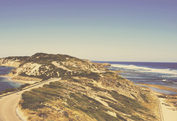 Our favourite places to wear SunButter sunscreen. Image of a thing stretch of land and ocean at Point Nepean National Park.