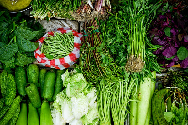 Why shopping local is important - aerial image of green vegetables on a table