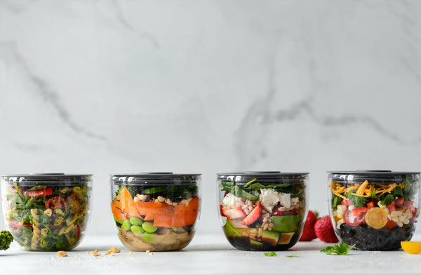 Plastic Free July: A line-up of glass containers filled with fresh food