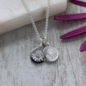 tiny paw print necklace personalised with pets name and engraved in sterling silver, 8mm