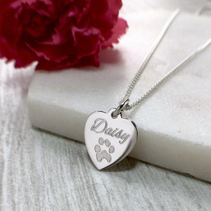 actual pet paw print engraved on a sterling silver heart with name engraved above