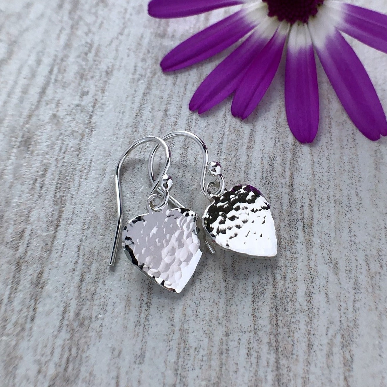 small sterling silver heart earrings with a hammered finish