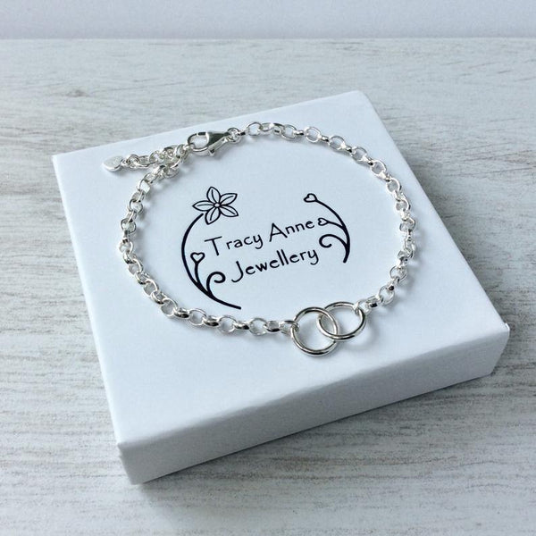 Sterling silver bracelet with two interlocking rings to symbolise love or friendship