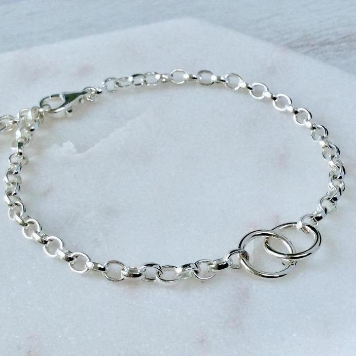 Sterling silver bracelet with two linked rings to symbolise love or friendship