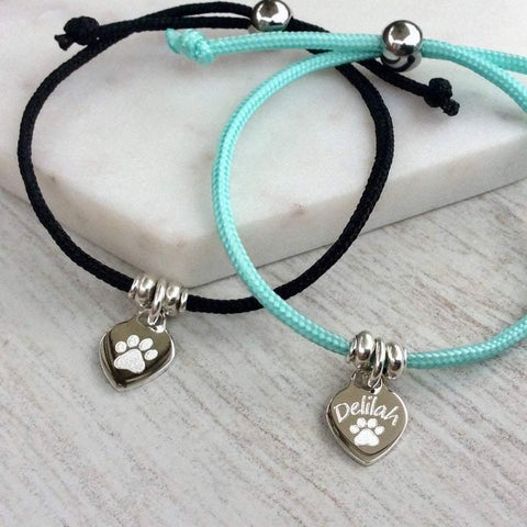 Cord bracelet with silver heart charm, engraved with paw print and your pet's name.  Adjustable with 9 colours to choose from