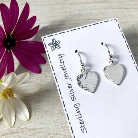 Small sterling silver drop earrings with hammered heart