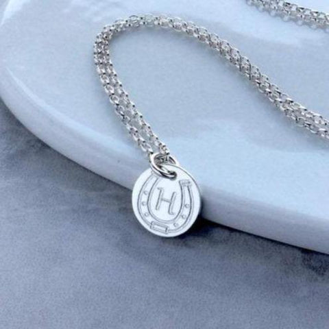 horseshoe necklace with initial engraved in centre of horseshoe, sterling silver