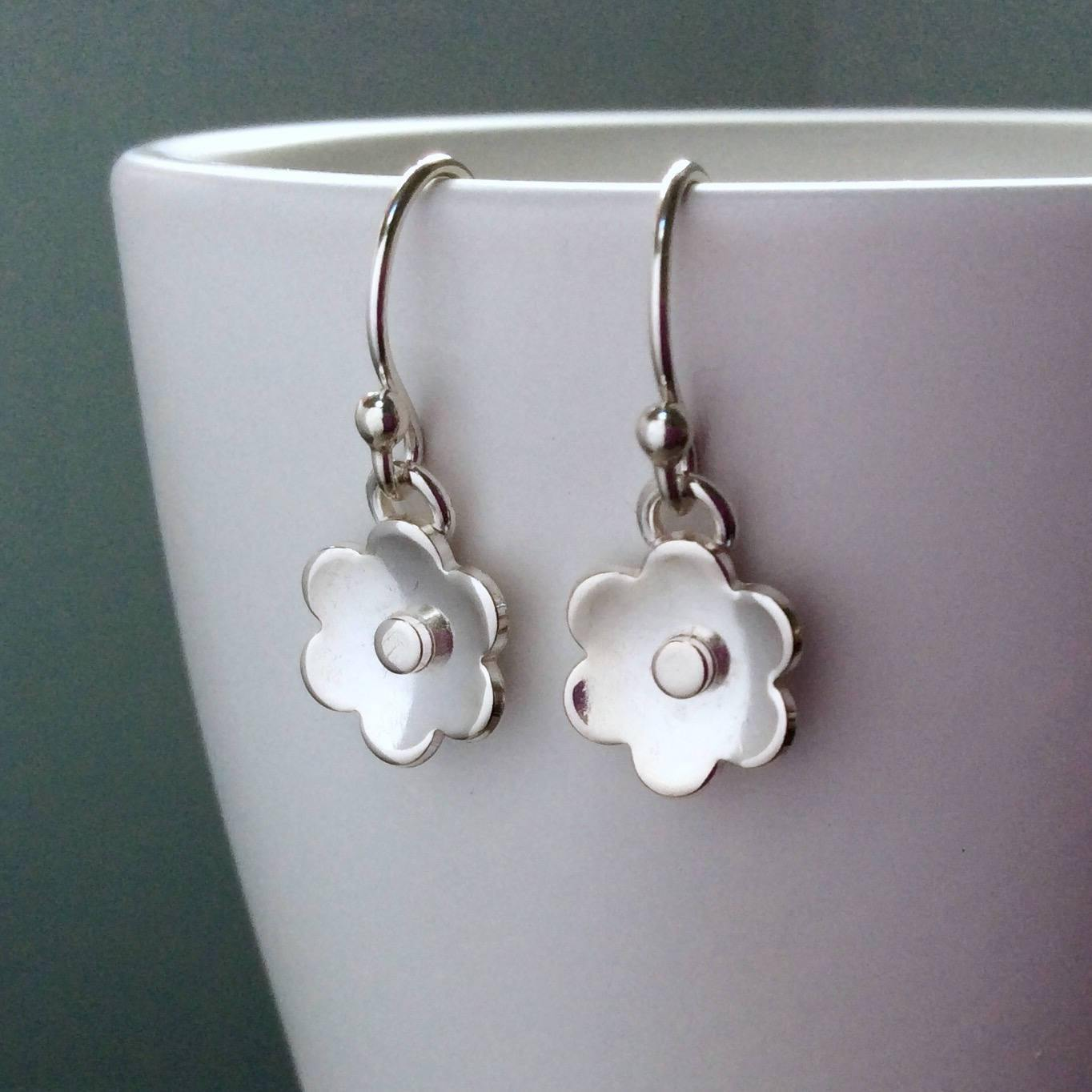 Earrings with sterling silver flower design, dainty and simple with silver centre