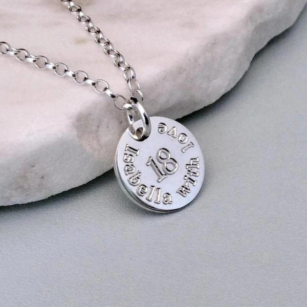 18th birthday gift, engraved onto a 12mm sterling silver disc with birthday girl's name added to the front design