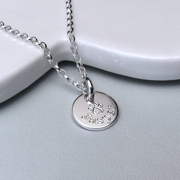Paw print necklace engraved with pet's name, small and dainty