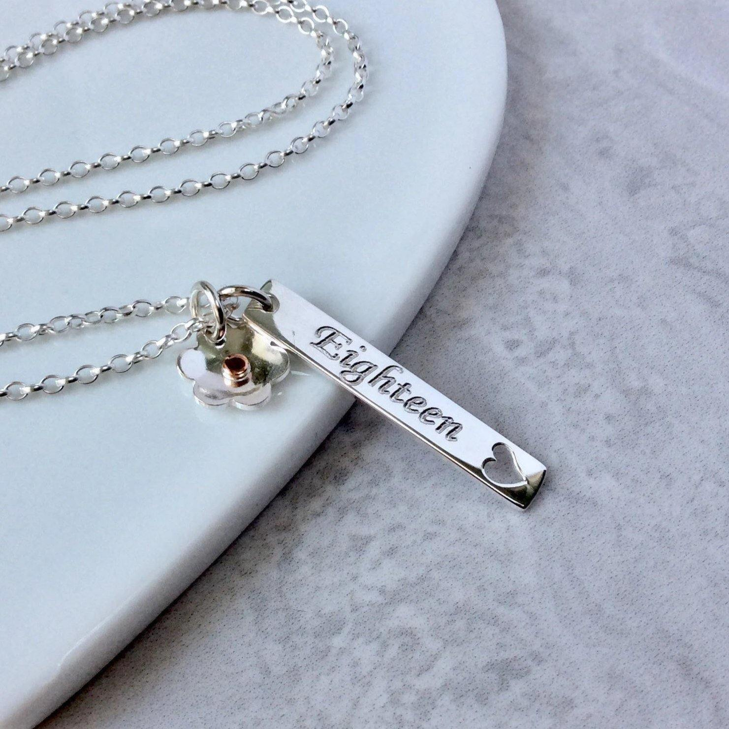 18th birthday gift, bar pendant personalised in sterling silver with small flower charm