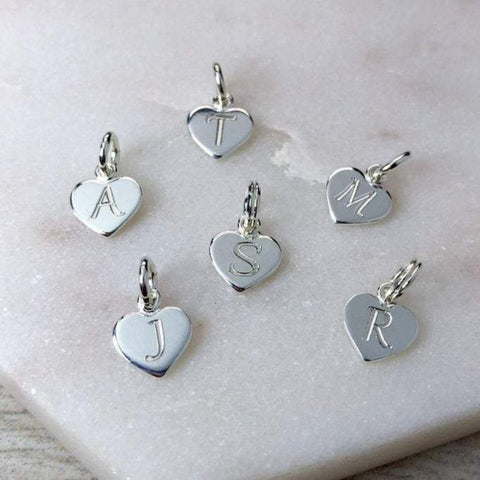 Tiny initial charms engraved onto 8mm wide sterling silver hearts