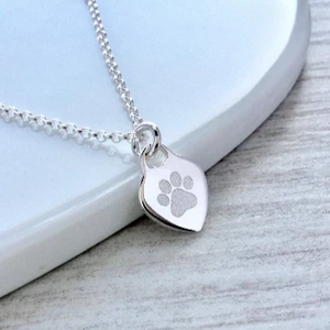 Paw print necklace, small and dainty heart pendant with pet's name on the back. sterling silver