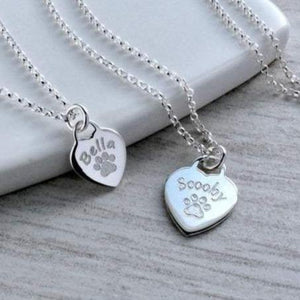 Personalised paw print necklace, engraved with your pet's name on a sterling silver heart