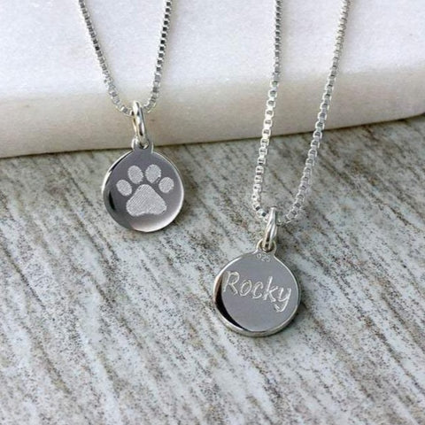 tiny paw print necklace with pet's name engraved on the back, 8mm wide