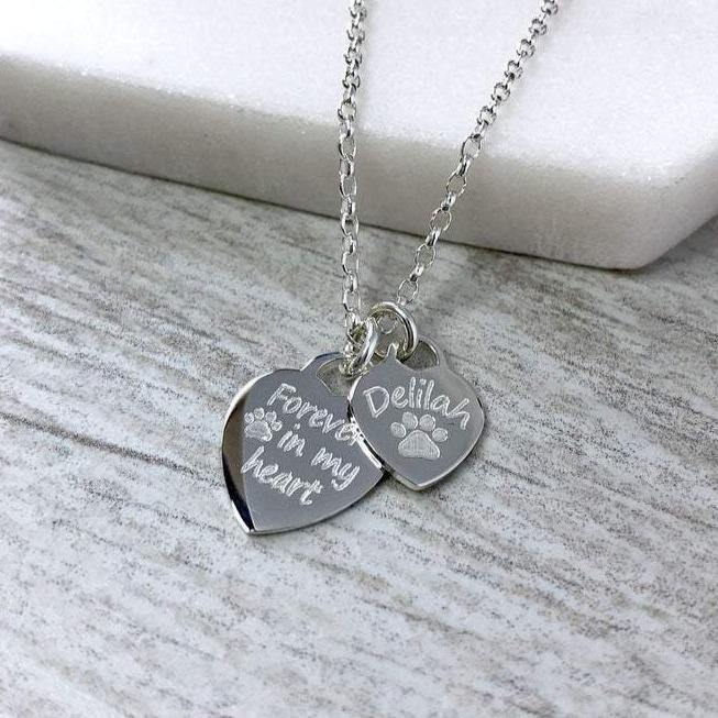 Pet memorial necklace with two sterling silver hearts. Forever in my heart on one and your pet's name on the second.