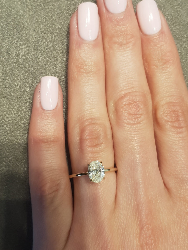 1.02 Carats Oval Cut Solitaire Diamond Engagement Ring