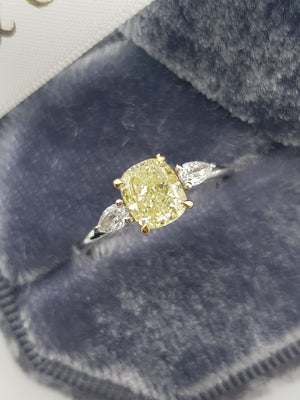 1.30 Carats Fancy Yellow Cushion Cut with 2 Pear Shape Side Stones Diamond Ring
