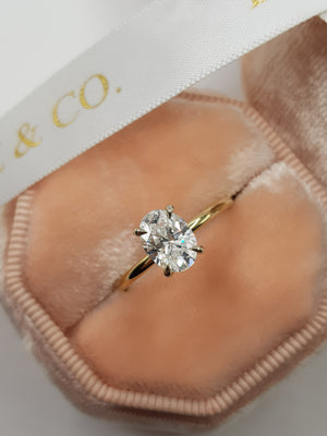 1.15 Carats Oval Cut Solitaire Hidden Halo Diamond Engagement Ring