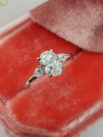1.30 Carats Oval Cut with Pear Shape Side Stones Diamond Engagement Ring