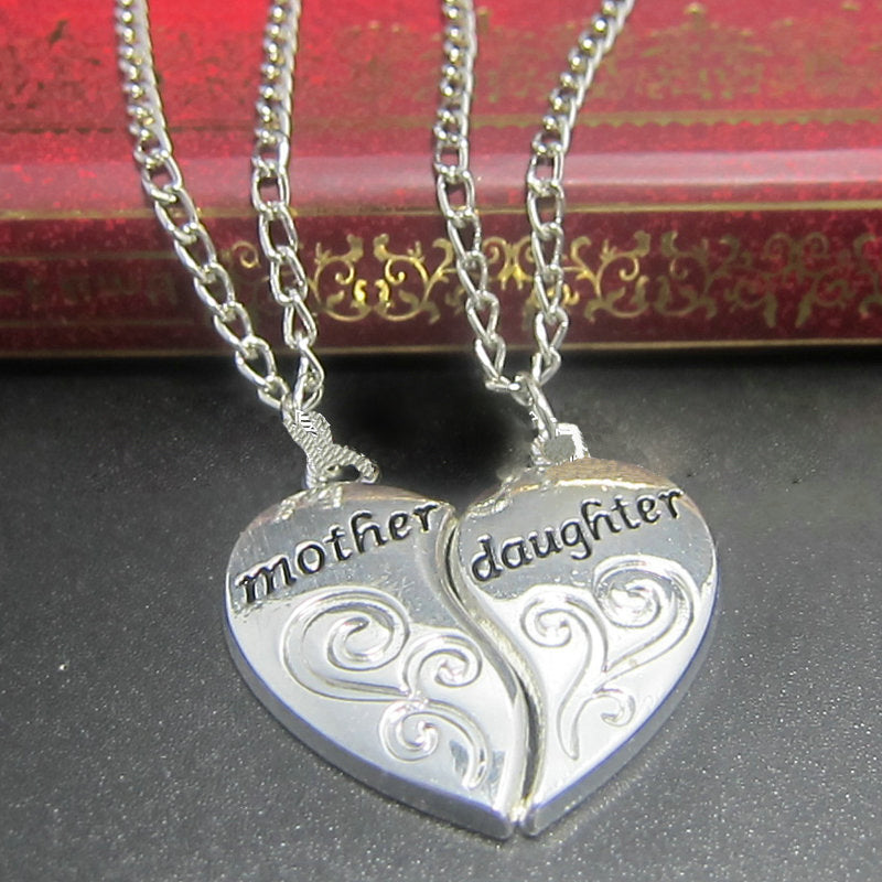 2pcs silver plated mother daughter heart shaped neckace grab one 2pcs silver plated mother daughter heart shaped neckace aloadofball Choice Image