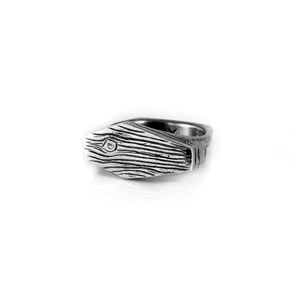 "Sterling silver ""Death At Sea"" ring, one side depicts a wood grain coffin and the bottom is engraved with the ancient native symbol for the ocean"