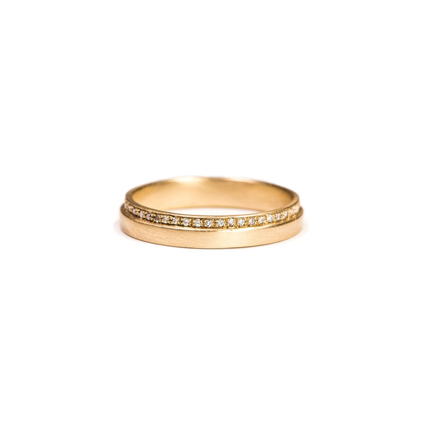 Carla Caruso modern wedding band with 44 tiny diamonds in 14k gold