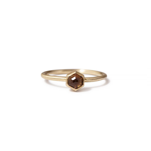 One-of-a-kind small brown hexagon spinel ring by heather guidero with sterling silver band and 18K gold bezel setting
