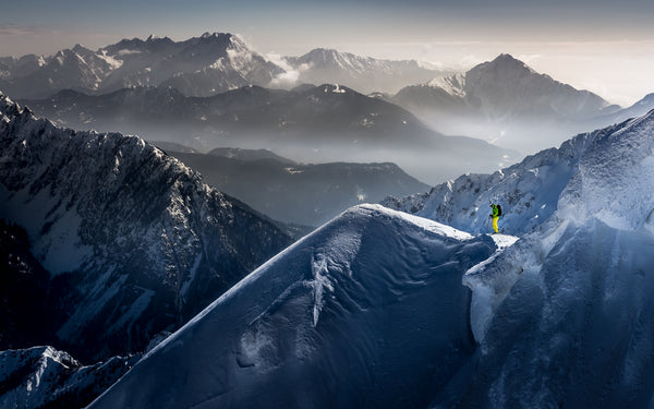 professional skier on top of an alpine mountain