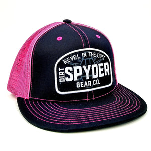 REVEL IN THE DIRT WOVEN PATCH PINK/BLACK TRUCKER HAT