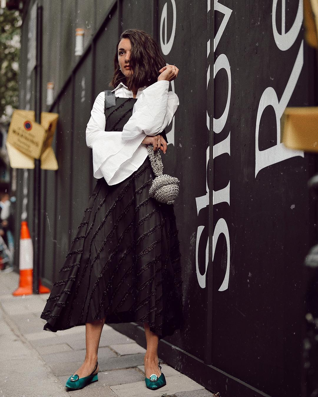 Fashion influencer Anisa Soijka spotted wearing the Simi Sparkle at London Fashion Week. MASHAMA dress and YUUL YIE shoes. Photo by David Nyanzi. silver clutch bag street style