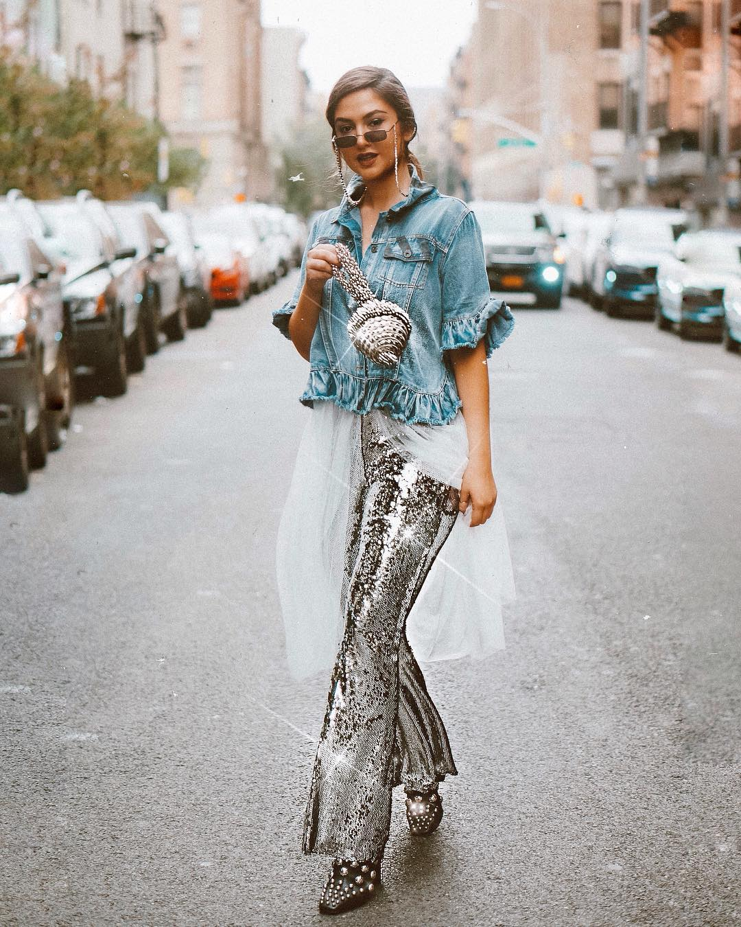 Lexiconofstyle's, Alexandra Dieck  spotted wearing the Simi Sparkle at New York Fashion Week street style. 15th September 2018. Mae Cassidy Silver clutch bag. handbag clutch bag bohoo kendall and kylie wrenandglory alexanderwangny Alexander wang studded boots nowandzenpr goodley bullen pr clutch denim jacket wren + glory sparkly trousers