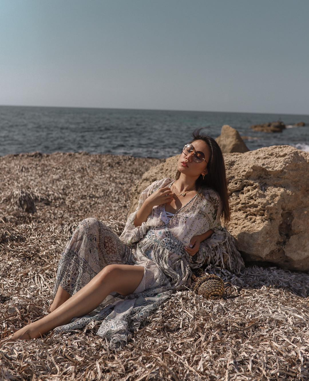 Simi sparkle Mae CASSIDY GOLD SPARKLY CLUTCH BAG UK The Haute Heel's columnist Evening Standard's top 25 Influencer of the year Andrea Cheong Cyprus  Camilla With Love printed dress Chloe Sunglasses holiday style summer occasion wear beach