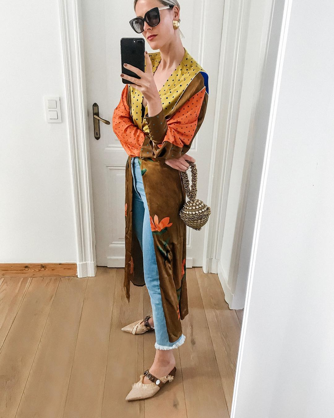 Fashionista's resident columnist Sofie Valkiers casual Autumn twist on Summer dress Mae Cassidy, Antique Gold sparkly Simi Sparkle clutch bag styled  Silvia Tcherassi  Citizens of Humanity jeans woven Uterqüe silders Jimmy Choo sunglasses bracelet bag