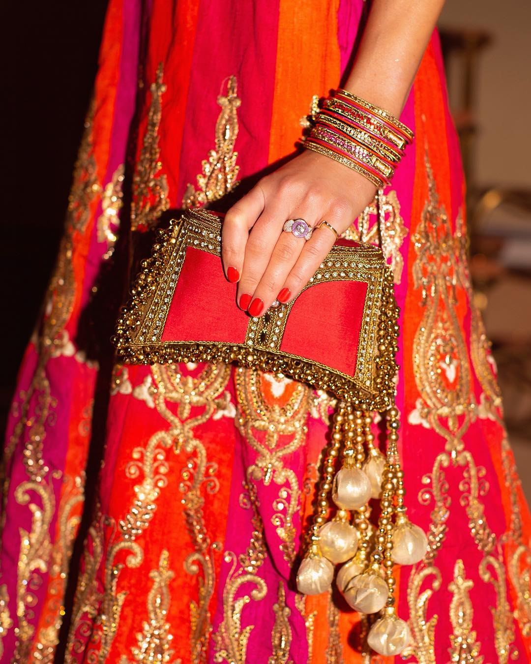 Drapers 30 under 30 founder Fash Mash Digital Strategist Brand Consultant Rosanna Falconer styles Mae Cassidy Fiery Red Zeenat Clutch Bag cross body silk gold handbag occasion wear party wear 2019 her Highness Rahman's Padmini Devi of Jaipu British Polo Day Gala dinner red carpet black tie Jaipur City Palace Traditional Indian National dress Lehenga Choli orange pink gold lime Pink city of Jaipur Rajasthani artisans gala Rosanna rose petals elephants horses camels city gates