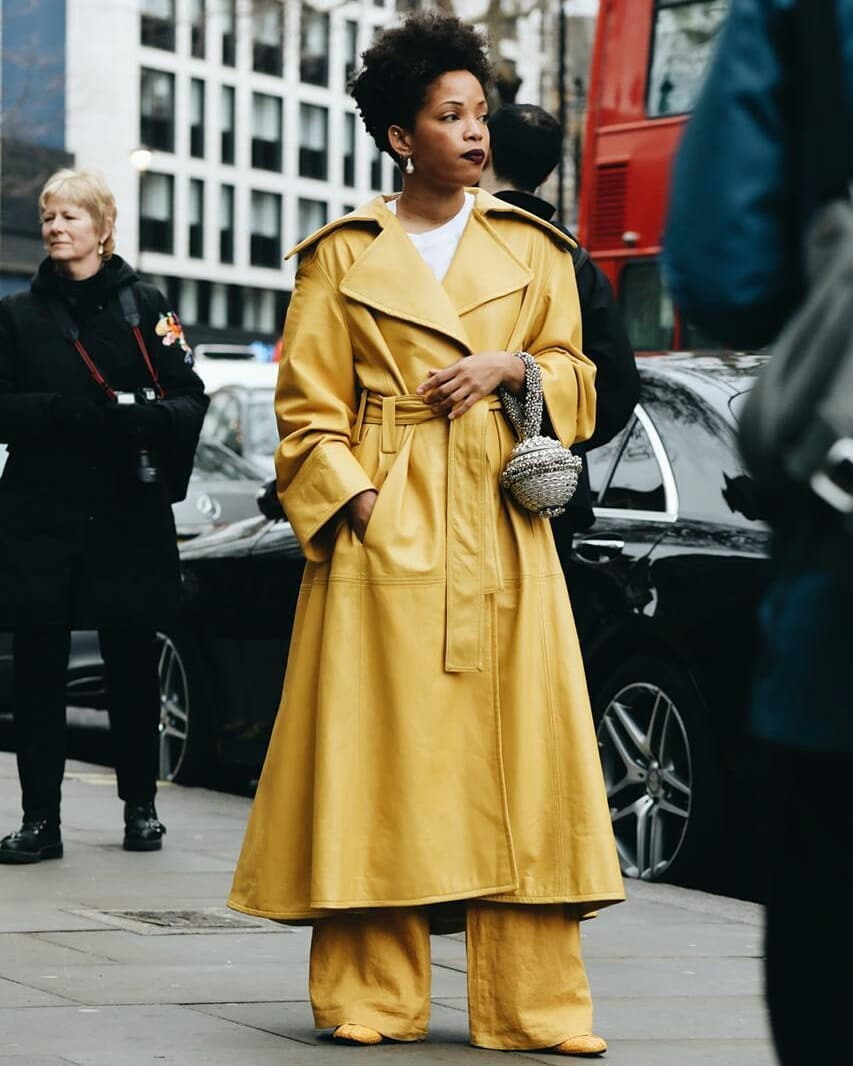 Slip Into Style influencer blogger Ellie Erdem Autumn Winter 2019 show wearing Mae Cassidy at London Fashion Week street style statement styling Silver Simi Sparkle clutch bag white tee head to toe colour Mustard yellow.