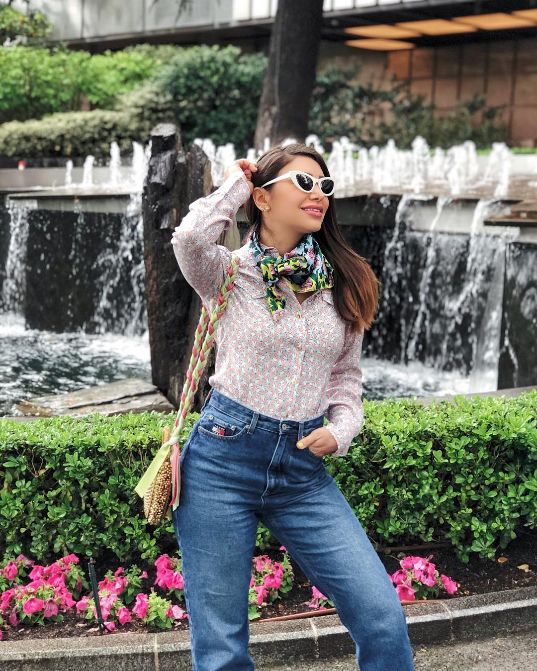 Celebrity Stylist Maya Williamz styles Mae Cassidy Malini Dream Gold Handbag Madrid holiday London Dubai pink green pastel SS19  Ribbon plaited cross-body 70's twist Jeans vintage Damsel in a Dress inspired shirt effortless spring summer day wear look accessorised YOLKE Floral Silk Scarf